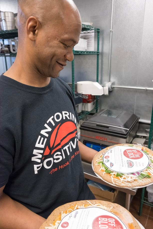 Will Green of Mentoring Positives holding Off the Block Pizzas